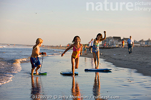 Children Playing With Boogie Boards On Hampton Beach New Hampshire Usa August 2008 Model Released