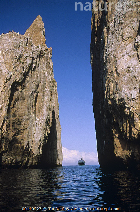 Kicker Rock, an old eroded tufa formation with tour vessel, near San Cristobal Island, Galapagos Islands, Ecuador  ,  Color Image, Day, Ecotourism, Ecuador, Erosion, Galapagos, Galapagos Islands, ILCP, Kicker Rock, Low Angle View, Nobody, One Object, Photography, San Cristobal Island, Tour Vessel, Tufa Cone, Vertical,Ecuador  ,  Tui De Roy