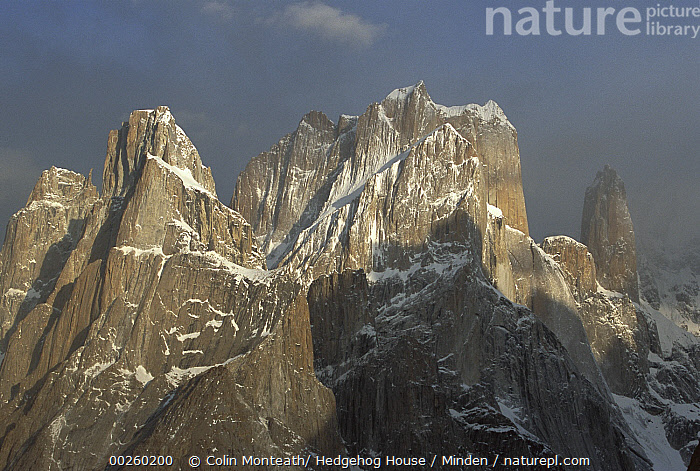 Trango Peaks, 6,286 meters elevation, and clearing storm at dawn above Baltoro Glacier, Karakoram Mountains, Pakistan  ,  Clearing, Cloud, Color Image, Day, High Elevation, Horizontal, Karakoram Mountains, Landscape, Low Angle View, Nobody, Outdoors, Pakistan, Peak, Photography, Snow, Storm, Trango Peaks,Pakistan  ,  Colin Monteath