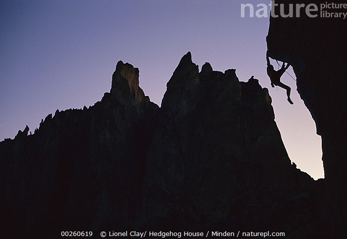 Climber silhouetted on Chain Reaction, a 5.12c route, Smith Rocks, Oregon  ,  Adventure, Climber, Climbing, Color Image, Day, Horizontal, One Person, Oregon, Outdoors, Person, Photography, Silhouette,Oregon  ,  Lionel Clay