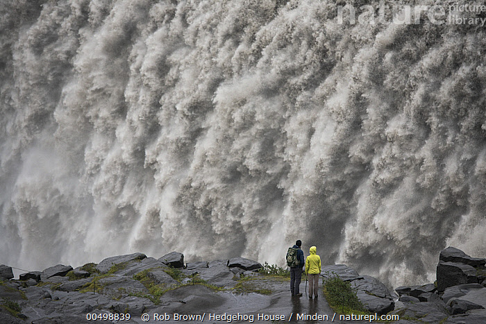 Tourists admiring Dettifoss Waterfall, Vatnajokull National Park, Iceland, Cascade, Color Image, Day, Dettifoss Waterfall, Ecotourism, Full Length, High Angle View, Horizontal, Human in Landscape, Iceland, Landscape, Outdoors, Photography, Power, Powerful, Rear View, Scale, Tourism, Tourist, Two People, Vatnajokull National Park, Waterfall,Iceland, Rob Brown