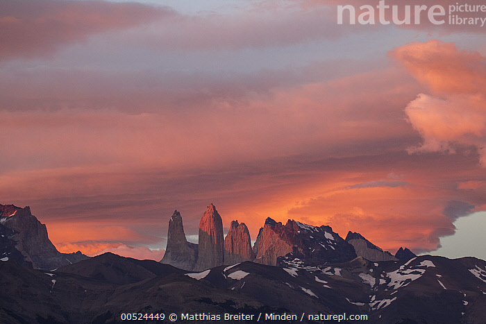 Storm clouds at sunrise above Torres del Paine as seens from Azul Lagoon, Torres del Paine National Park, Chile  ,  Azul Lagoon, Chile, Cloud, Cloudy, Color Image, Day, Horizontal, Landscape, Mountain, Mountain Range, Nobody, Outdoors, Patagonia, Peak, Photography, Pink, Sky, Storm, Sunrise, Sunset, Torres Del Paine National Park, Torres Del Paine,Chile  ,  Matthias Breiter