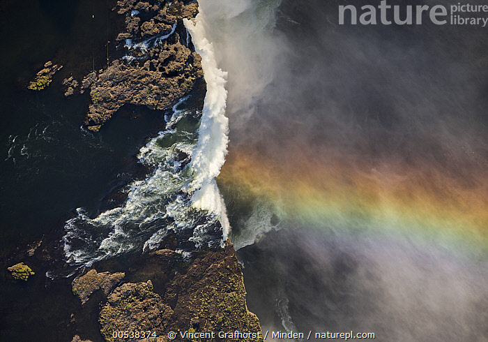 Victoria Falls cascading 420 feet into chasm, largest waterfall in the world with rainbow, UNESCO World Heritage Site, Zimbabwe  ,  Aerial View, Color Image, Day, Horizontal, Landscape, Largest, Mist, Nobody, Outdoors, Photography, Rainbow, Victoria Falls, Victoria Falls National Park, Waterfall, World Heritage Site, Zimbabwe,Zimbabwe  ,  Vincent Grafhorst