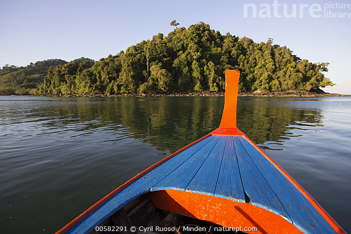 Boat near forest-covered island, Piak Nam Yai Island, Thailand, Blue Sky, Boat, Coast, Color Image, Day, Forest, Horizontal, Island, Landscape, Nobody, Outdoors, Photography, Piak Nam Yai Island, Thailand,Long-tailed Macaque,Thailand, Cyril Ruoso