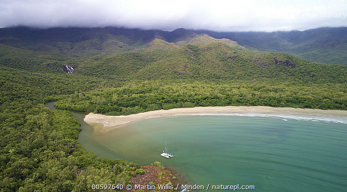 Boat in Zoe Bay surrounded by rainforest, Hinchinbrook Island National Park, Queensland, Australia  ,  Adventure, Aerial View, Australia, Bay, Boat, Coast, Color Image, Day, Hinchinbrook Island National Park, Horizontal, Landscape, Nobody, Outdoors, Panoramic, Photography, Queensland, Rainforest, Travel, Tropical, Zoe Bay  ,  Martin Willis