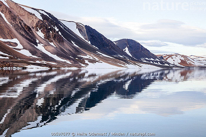 Coastal mountains, Heclahamna, Sorgfjorden, Svalbard, Norway  ,  Coast, Color Image, Day, Heclahamna, Horizontal, Landscape, Mountain, Mountain Range, Nobody, Norway, Outdoors, Photography, Reflection, Sorgfjorden, Svalbard, Tranquility  ,  Heike Odermatt