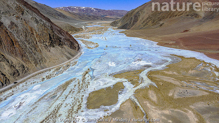 Frozen river in valley, Altai Mountains, Bayan Ulgii, Mongolia  ,  Altai Mountains, Bayan Ulgii, Blue Sky, Color Image, Day, Frozen, Horizontal, Landscape, Mongolia, Nobody, Outdoors, Photography, River, Valley  ,  Jami Tarris