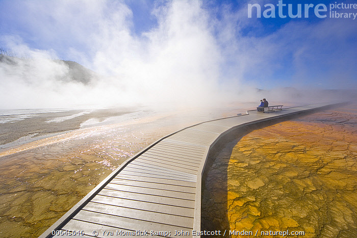 Tourists and hot spring, Grand Prismatic Spring, Yellowstone National Park, Wyoming  ,  Bacteria,Blue Sky,Boardwalk,Color Image,Day,Full Length,Geothermal,Grand Prismatic Spring,Horizontal,Hot Spring,Landscape,Lone,Mist,Outdoors,Photography,Side View,Solitude,Spirituality,Tourism,Tourist,Two People,Wyoming,Yellowstone National Park,Bacteria,Blue Sky,Boardwalk,Color Image,Day,Full Length,Geothermal,Grand Prismatic Spring,Horizontal,Hot Spring,Landscape,Lone,Mist,Outdoors,Photography,Side View,Solitude,Spirituality,Tourism,Tourist,Two People,Wyoming,Yellowstone National Park  ,  Yva Momatiuk & John Eastcott