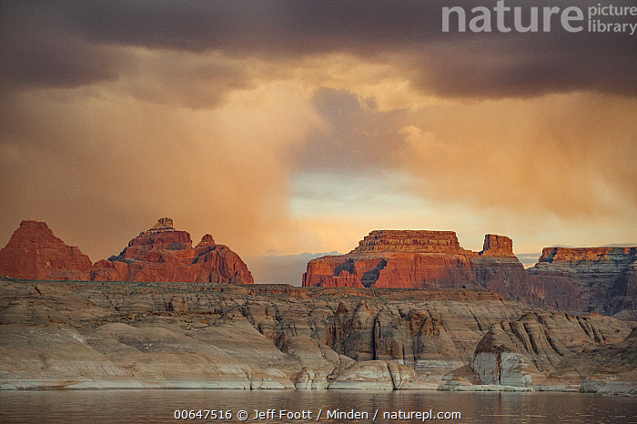 Buttes at sunset, Face Canyon, Lake Powell, Glen Canyon National Recreation Area, Utah  ,  Butte,Color Image,Day,Face Canyon,Glen Canyon National Recreation Area,Horizontal,Lake Powell,Landscape,Nobody,Outdoors,Photography,Stormy Sky,Sunrise,Sunset,Utah  ,  Jeff Foott