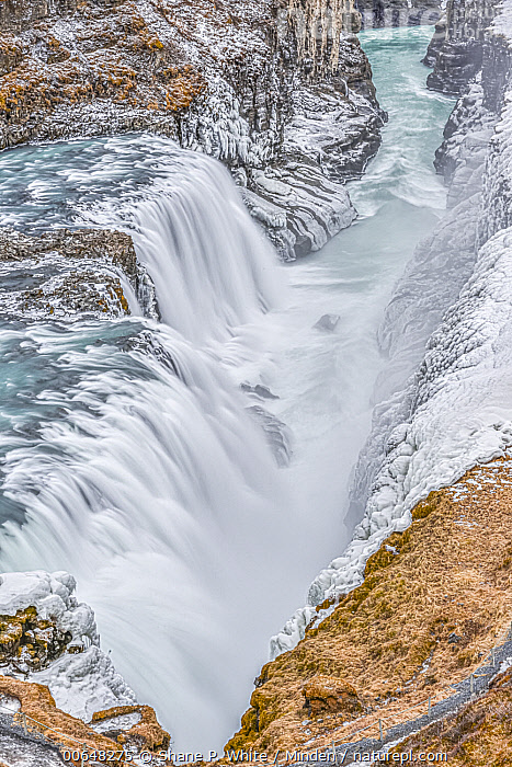 Waterfall in winter, Golden Circle, Iceland  ,  Aerial View,Color Image,Day,Erosion,Golden Circle,Iceland,Inspirational,Landscape,Long Exposure,Nobody,Outdoors,Photography,Time Exposure,Vertical,Waterfall,Winter  ,  Shane P. White