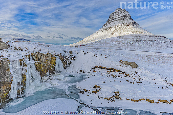 Waterfall and mountain in winter, Grundarfjordur, Iceland  ,  Blue Sky,Color Image,Day,Grundarfjordur,Horizontal,Iceland,Landscape,Mountain,Nobody,Outdoors,Peak,Photography,Snow,Tranquility,Waterfall,Winter  ,  Shane P. White