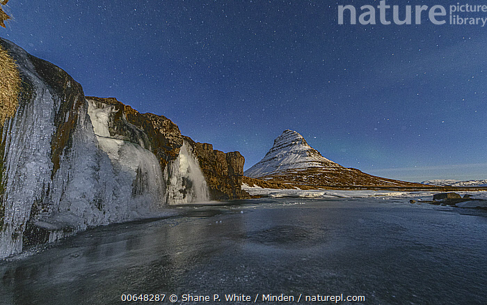 Frozen waterfall and mountain at night, Grundarfjordur, Iceland  ,  Cliff,Color Image,Frozen,Grundarfjordur,Horizontal,Iceland,Landscape,Mountain,Night,Nobody,Outdoors,Peak,Photography,Snow,Star,Waterfall,Winter  ,  Shane P. White