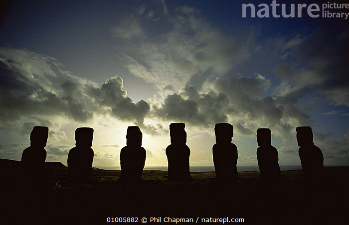 Giant Moai statues at A Kivi silhouetted against stormy sky in southern part of Easter Island  ,  BUILDINGS,OCEANIA,PACIFIC ISLANDS,SILHOUETTES,SUNSET  ,  Phil Chapman
