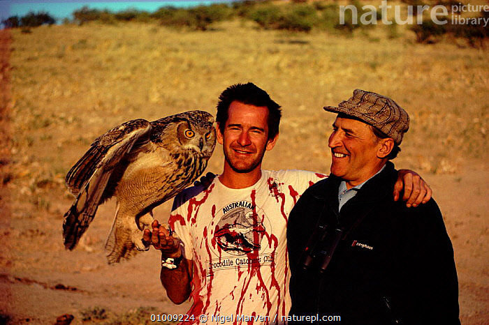Nigel Marven, Nikolai Drozdov and Bubo (Great eagle owl) on location for filming of TV series 'Realms of the Russian Bear'  ,  BEAR,BIRDS,BIRDS OF PREY,BUBO,DROZDOV,EAGLES,HORIZONTAL,MARVEN,NIGEL,NIKOLAI,OF,OWLS,PEOPLE,RAPTOR,REALMS,RUSSIAN,THE  ,  NIGEL MARVEN