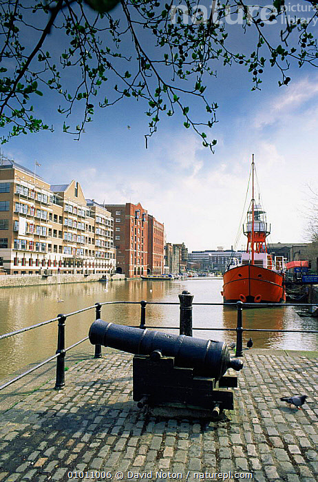 Bristol harbour with old cannon and Lightship, Welsh Back and Redcliffe Quay. Bristol, England, BOATS,BUILDINGS,CITIES,EUROPE,GUN,LANDSCAPES,UK,URBAN,VERTICAL,United Kingdom,British, United Kingdom, United Kingdom, David Noton