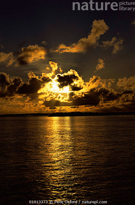 Sunset over Aldabra Island, Seychelles, Indian Ocean  ,  ASIA,ATMOSPHERIC,CLOUDS,COASTS,DUSK,INDIAN OCEAN,ISLANDS,MARINE,PEACEFUL,SEA,SEYCHELLES,SKY,SUNLIGHT,SUNSET,TROPICAL,VERTICAL,Concepts,Weather,INDIAN OCEAN ISLANDS  ,  Pete Oxford