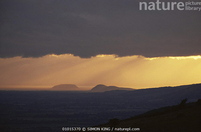 Sunset over Steep Holm, with the sun behind cloud, Bristol channel, UK  ,  ATMOSPHERIC,CLOUDS,INTERESTING,LANDSCAPES,SKIES,SKY,SUN,SUNSET,WEATHER  ,  SIMON KING