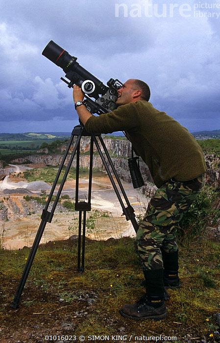Simon King filming in a quarry for BBC programme, England, UK  ,  CAMERA,CAMERAS,ENGLAND,EUROPE,FILMING,FILMING IN WILD,NHU,PEOPLE,QUARRIES,SUMMER,TRIPOD,UK,VERTICAL,United Kingdom,British  ,  SIMON KING