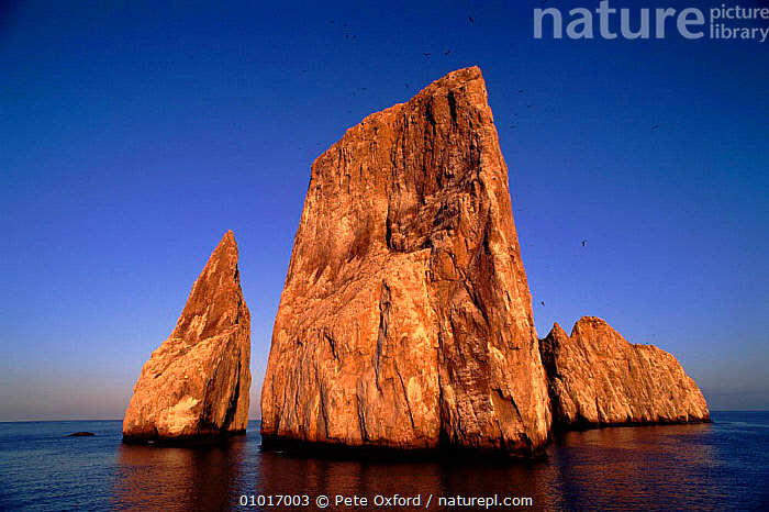 Kicker Rock, Galapagos  ,  CLIFFS,KICKER,OUTSTANDING,HOLIDAYS,SKY,ISLANDS,ROCK FORMATIONS,HORIZONTAL,ROCK,SEA,CONCEPTS,GEOLOGY,SOUTH-AMERICA  ,  Pete Oxford