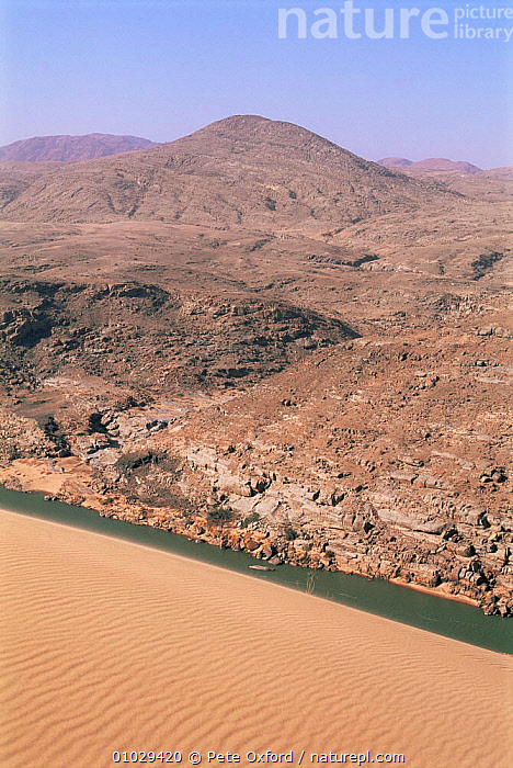 Kunene river borders Angola (background) and Namibia (foreground)., AFRICA,DESERTS,LANDSCAPES,RIVERS,SOUTHERN AFRICA, Pete Oxford