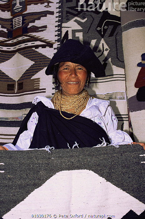 Otavalo Indian woman selling weavings, Otovalo market, Andes, Ecuador, CRAFTSMANSHIP,CULTURES,FEMALES,PEOPLE,PORTRAITS,SOUTH AMERICA,TRADE,TRADITIONAL,TRIBES,VERTICAL,WEAVING,WOMAN, Pete Oxford
