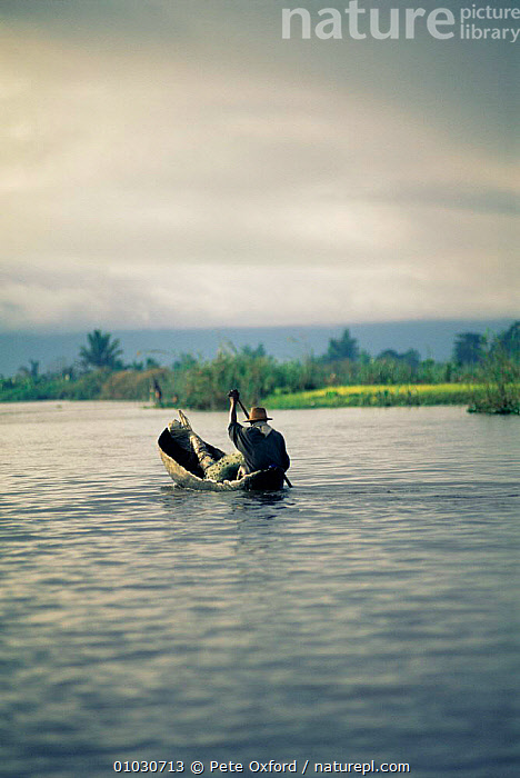 Rear view of local fisherman in dugout canoe, Maroansetra, Madagascar., AFRICA,BOATS,CULTURES,HUNTING FOOD,MADAGASCAR,PEOPLE,RIVERS,TOURISM, Pete Oxford