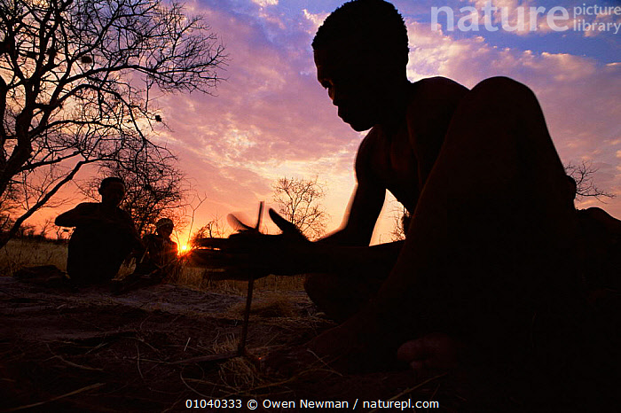 Silhouette of Jo / Hoan bushman making fire Bushmanland, Namibia. 1996  ,  AFRICA,CULTURES,FIRE,PEOPLE,SILHOUETTES,SKY,SOUTHERN AFRICA,SUNSET,TRIBES  ,  Owen Newman