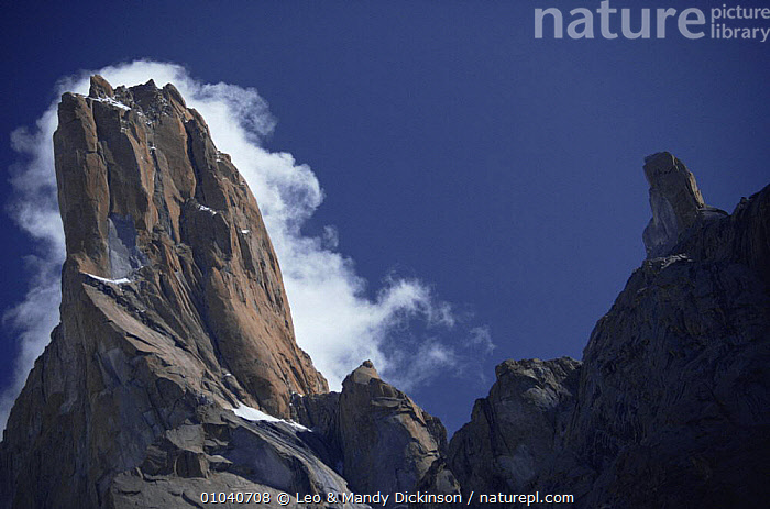 Looking up at Trango Tower in the Karakorum Mountains, Pakistan  ,  ALPINE,ASIA,CLOUDS,GEOLOGY,INDIAN SUBCONTINENT,LANDSCAPES,MOUNTAINS,ROCK FORMATIONS,ROCKS,RUGGED,Weather,INDIAN-SUBCONTINENT  ,  Leo & Mandy Dickinson