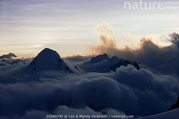 Sun setting over Pumori from North Col of Everest with clouds below, Himalayas, Nepal  ,  ASIA,himalayas,INDIAN SUBCONTINENT,MOUNTAINS  ,  Leo & Mandy Dickinson