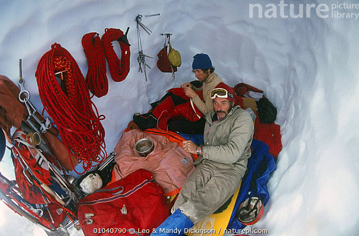 Eric Jones and Rick Sylvester in an ice cave, Patagonia, Argentina, 1972  ,  BUILDINGS,CAVES,EQUIPMENT,ICE,LEISURE,MOUNTAINEERING,MOUNTAINS,OUTDOOR PURSUITS,PEOPLE,PORTRAITS,SNOW,SOUTH AMERICA,SURVIVAL  ,  Leo & Mandy Dickinson