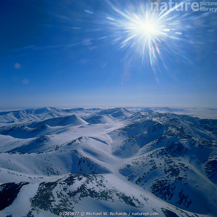 Aerial view of Wrangel Island with spring sunshine before the annual melt, Siberia, Russia Arctic  ,  AERIALS,ARCTIC,ASIA,CIS,HIGHLANDS,LANDSCAPES,MOUNTAINS,RUSSIA,SNOW,SPRING,SUN,sunlight,Sunshine,VERTICAL  ,  Michael W. Richards