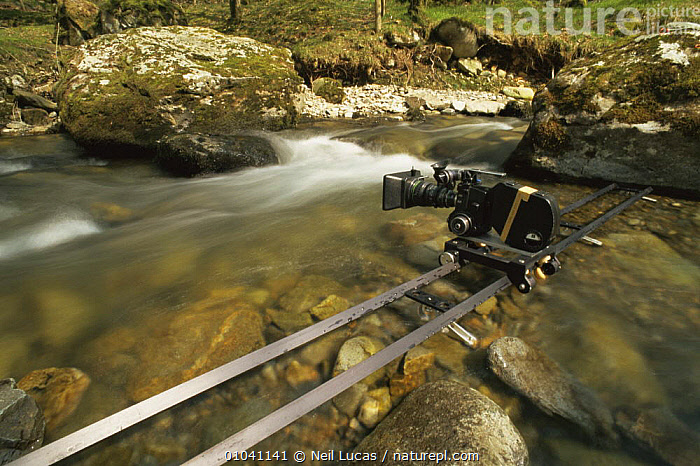 Film camera mounted on track to capture running water, 1998  ,  EUROPE,FILMING,NHU,RIVERS,WALES,WATER  ,  Neil Lucas