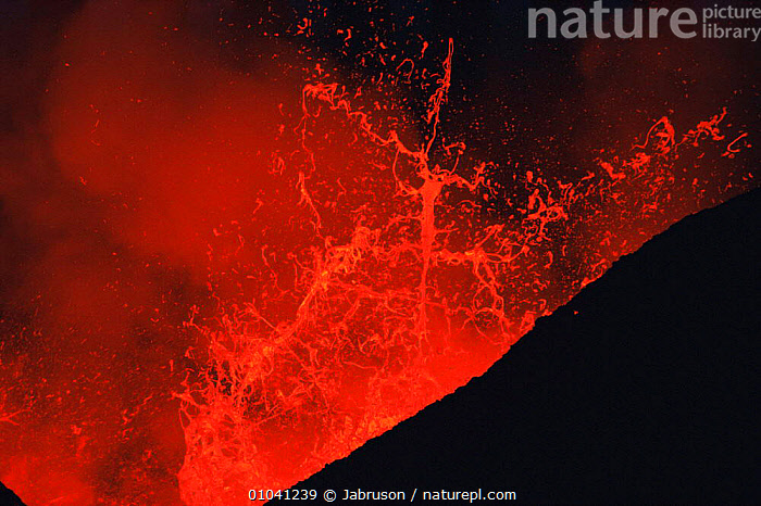 Lava explodes from active volcano, Kimanura eruption, Virunga NP, Democratic Republic of Congo (formerly Zaire)  ,  ACTIVE,AFRICA,CENTRAL AFRICA,DRAMATIC,ERRUPTION,ERRUPTS,EXPLODES,EXPLOSION,LAVA,MOLTEN,NIGHT,NP,RED,VOLCANIC,VOLCANOES,Geology,National Park , Bruce Davidson  ,  Jabruson