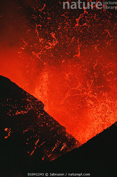 Lava explodes from active volcano, Kimanura eruption, Virunga NP, Democratic Republic of Congo (formerly Zaire)  ,  ACTION,ACTIVE,AFRICA,CENTRAL AFRICA,DRAMATIC,ERRUPTION,LAVA,MOLTEN,NIGHT,NP,RED,VERTICAL,VOLCANIC,VOLCANOES,Geology,National Park,Catalogue1 , Bruce Davidson  ,  Jabruson