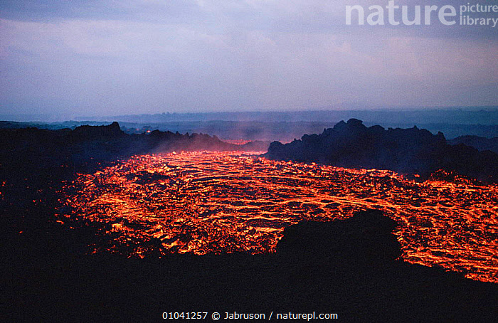 Red hot molten lava flow breaking through from base of Kimanura volcano, Virunga NP, Democratic Republic of Congo (formerly Zaire)  ,  ACTION,ACTIVE,AFRICA,CENTRAL AFRICA,DRAMATIC,FLOWING,GEOLOGY,HEAT,HIGHLANDS,HOT,LANDSCAPES,LAVA,MOLTEN,MOUNTAINS,STEAM,STREAM,VOLCANIC,VOLCANOES , Bruce Davidson  ,  Jabruson