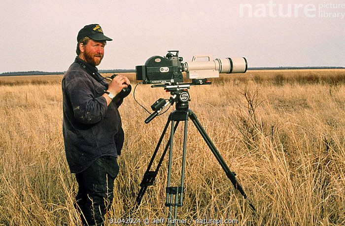 """Cameraman Jeff Turner on lookout for wolves, Wood Buffalo NP, Canada, 1996  ,  CAMERA,CANADA,EQUIPMENT,FILMING,LOCATION,NP,PEOPLE,PHOTOGRAPHER"""",""""NHU,PORTRAITS,RESERVE,WOLVES,North America,National Park  ,  Jeff Turner"""