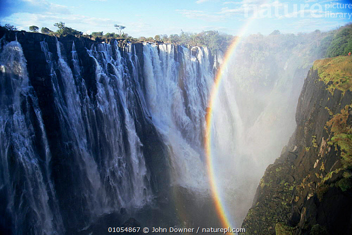 Victoria Falls showing rainbow. Zimbabwe, Southern Africa.  ,  AFRICA,ATMOSPHERIC,HORIZONTAL,RAINBOWS,RIVERS,SOUTHERN AFRICA,WATERFALLS,Weather  ,  John Downer