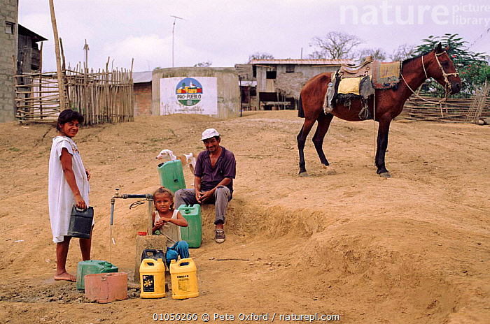 Filling water containers, rural water supply project. Pro Pueblo Foundation, Ecuador  ,  CONSERVATION,CONTAINERS,HORIZONTAL,INTERESTING,OXFORD,PEOPLE,PO,RURAL,SOUTH AMERICA,SUPPLY,VILLAGES,WATER  ,  Pete Oxford