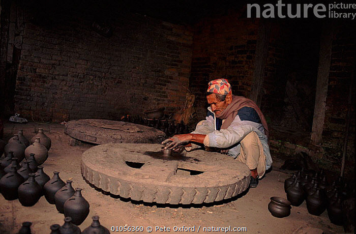 Potter working in Potter's Square, Bhaktapur, Nepal.  ,  POTTERY,INDUSTRY,ARTIFACTS,PO,OXFORD,CULTURES,PEOPLE,BHAKTAPUR,POTTER,TRADITIONAL,Asia  ,  Pete Oxford