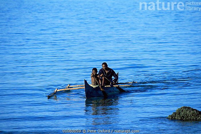 Local people in outrigger canoe, Nosy Komba Island, Madagascar, AFRICA,BOATS,LANDSCAPES,MADAGASCAR,PEOPLE,TRADITIONAL,WATER, Pete Oxford