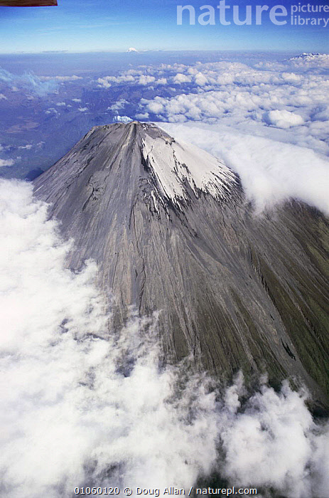 Aerial view of summit cone of Sangay, dormant volcano, Ecuador, AERIALS,ALTITUDE,CLOUDS,CONES,CRATERS,HIGHLANDS,LANDSCAPES,PEAK,SNOW,SOUTH AMERICA,SUMMIT,VERTICAL,VOLCANOES,Weather,Geology, Doug Allan