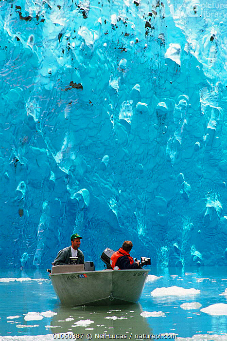 Small boat in water filming near blue iceberg, Alaska, USA, ICEBERG,BOAT,USA,SMALL,LUCAS,PATTERNS,BLUE,BOATS,FILMING,NEIL,WATER,COLOURFUL,NL,PEOPLE,ALASKA,MARINE,NORTH AMERICA, Neil Lucas