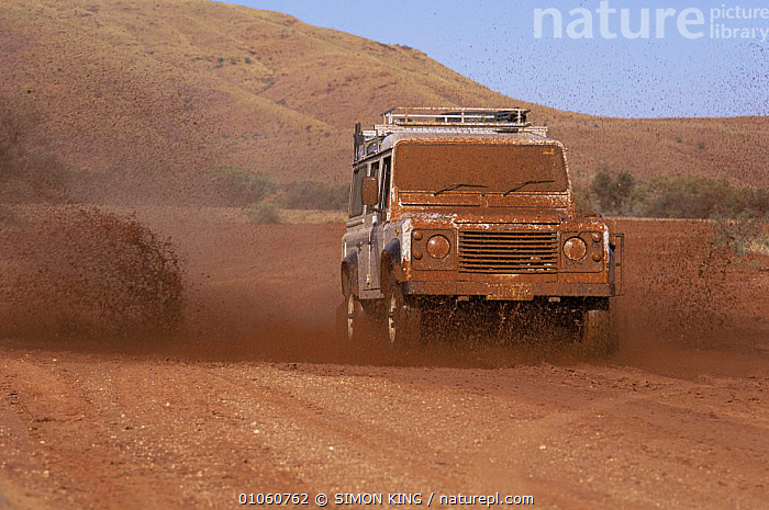 Land Rover Defender travelling along muddy track in Australian outback, ADVENTURE,AUSTRALIA,NHU,OFF ROAD,VEHICLES, SIMON KING