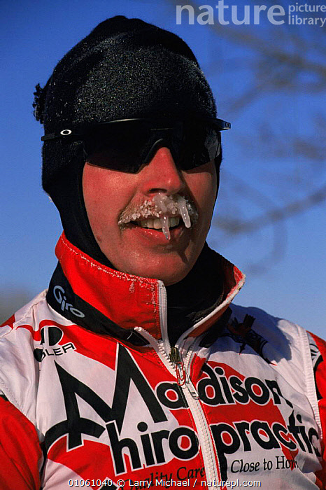 Cross country ski racer with frozen moustache and icicles, Wisconsin, USA, COLD,FACES,FROZEN,ICE,LEISURE,NORTH AMERICA,OUTDOOR PURSUITS,PEOPLE,PORTRAITS,SNOW,SPORT,TREES,USA,VERTICAL,WINTER,Plants, Larry Michael