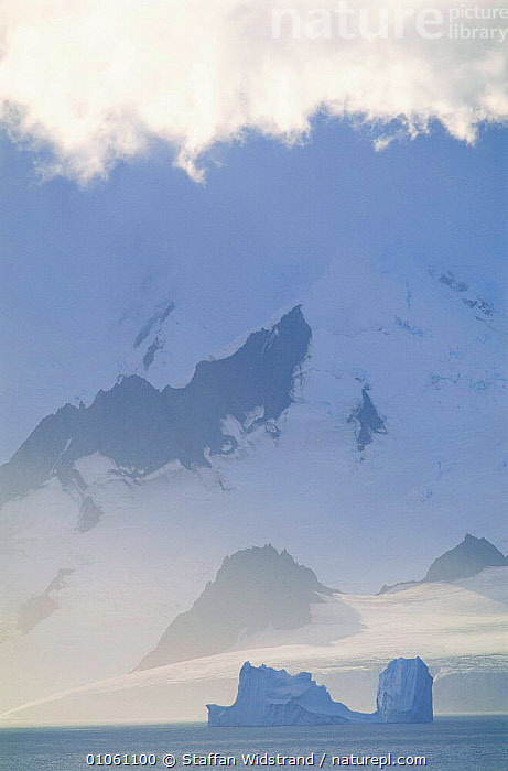 Coastline with iceberg, Antarctic Peninsula, ARTY SHOTS,CLOUDS,DRAMATIC,ICE,ICEBERGS,LANDSCAPES,PROW,ROCK FORMATIONS,SEA,SKY,SNOW,SUMMER,VERTICAL,WHITE,Weather,Geology,CONCEPTS,Catalogue1, Staffan Widstrand