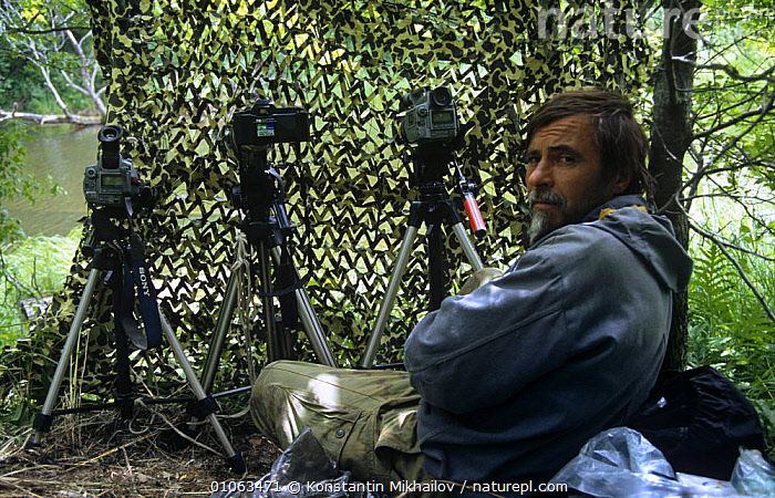 RussianpPhotographer Yuri Shibnev in hide, filming and photographing beside river in Primorsky, Far East Russia  ,  CAMERA,CAMERAMAN,CAMERAS,CAMOUFLAGE,FILMING IN WILD,HORIZONTAL,PEOPLE,RIVERS,RUSSIA  ,  Konstantin Mikhailov