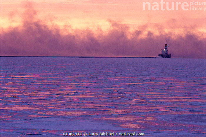 Winter fog approaching Lighthouse on Lake Michigan, in winter at -26 degrees C, Wisconsin, USA, BUILDINGS,DUSK,Fog,Frozen,ICE,LAKES,LANDSCAPES,NORTH AMERICA,SUNSET,USA,WATER,WINTER, Larry Michael