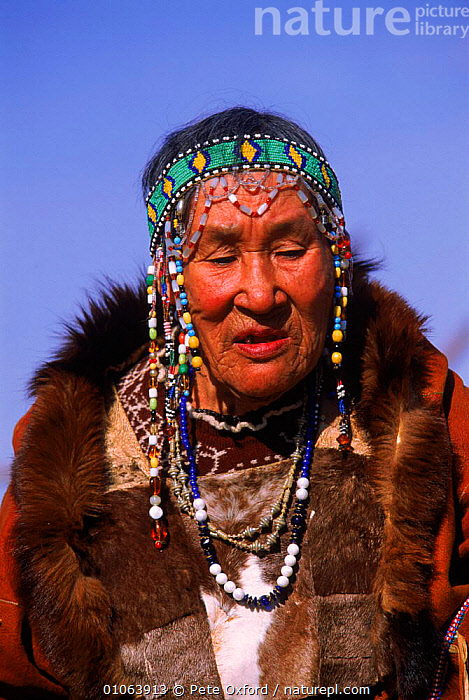 Koryak woman in traditional dress, Karaginsky Kamchatka Peninsula, Russia, HEADS,PENINSULA,COSTUME,KAMCHATKA,PEOPLE,NATIVE,FEMALE,OXFORD,PETER,TRADITIONAL,CULTURES,KORYAK,OSSORA,COLOURFUL,PORTRAITS,KARAGINSKY,JEWELLERY,PO,TRIBES,VERTICAL,DRESS,WOMAN,FACES,CIS, Pete Oxford