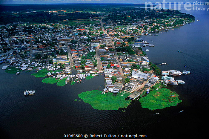 Aerial view of Tefe on banks of Amazon River, Brazil, AERIAL,AMAZON,AMERICA,BANKS,BUILDINGS,CITIES,FILMING,FULTON,HOMES,HORIZONTAL,LANDSCAPES,POPULATION,RFU,RIVER,RIVERS,ROBERT,SOUTH,SOUTH AMERICA,TEFE,TOWNS,VIEW ,AERIALS,SOUTH-AMERICA, Robert Fulton