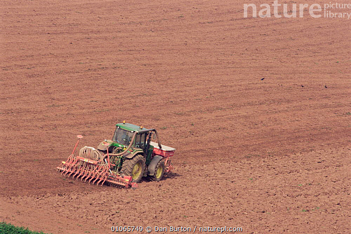 Tractor raking field and treating with chemicals, Devon, UK, AGRICULTURE,ENGLAND,EUROPE,FARMLAND,MACHINERY,UK,United Kingdom,British, Dan Burton